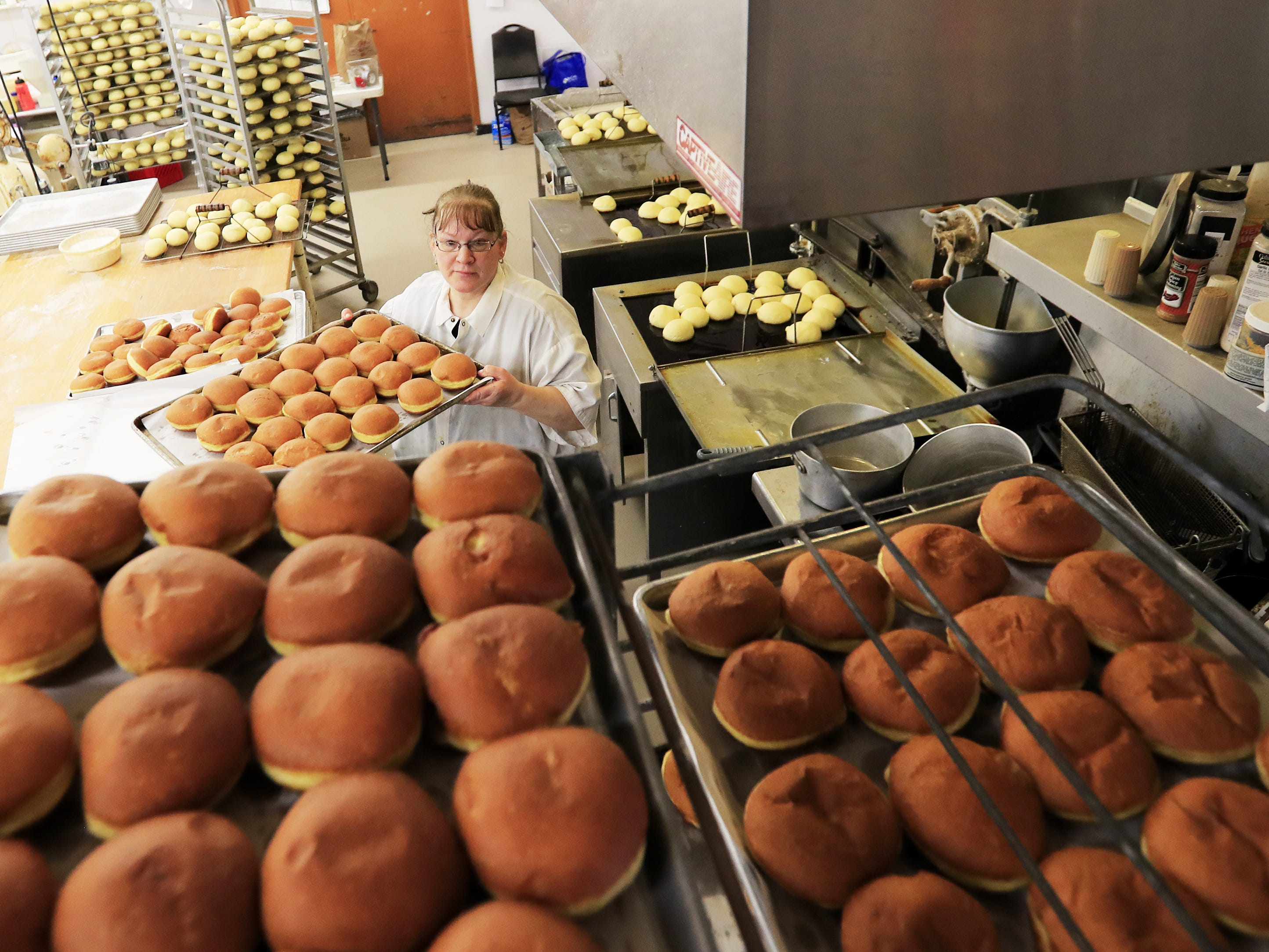 Janice Smurawa finishes a batch of paczki at Smurawa's Country Bakery on Tuesday, Feb. 26, 2019, in Pulaski.