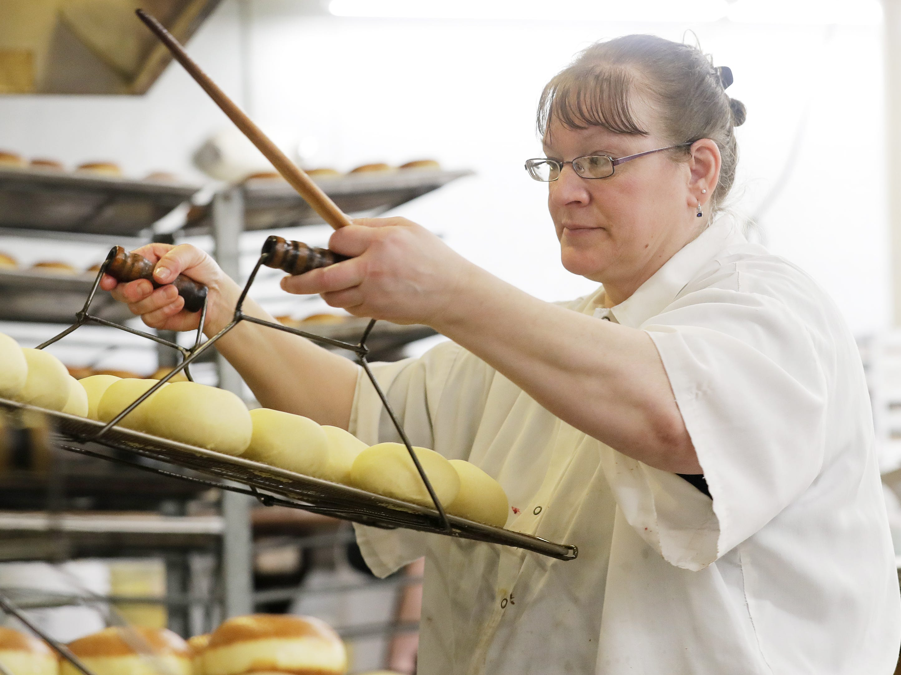 Janice Smurawa puts a batch of paczki in the fryer at Smurawa's Country Bakery on Tuesday, Feb. 26, 2019, in Pulaski.