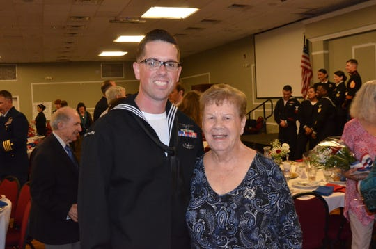 Petty Officer 1st Class Brian Clark stands with Margaret Flowers, namesake of the award that honors the military member for outstanding contributions to the community for the year. Clark won the prestigious award Feb. 21 in a luncheon sponsored by the Pensacola Council, Navy League of the United States.