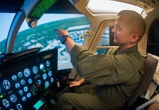 Marine Maj. Ron Chino tests out the new TH-57 flight simulators at Whiting Field on Thursday.