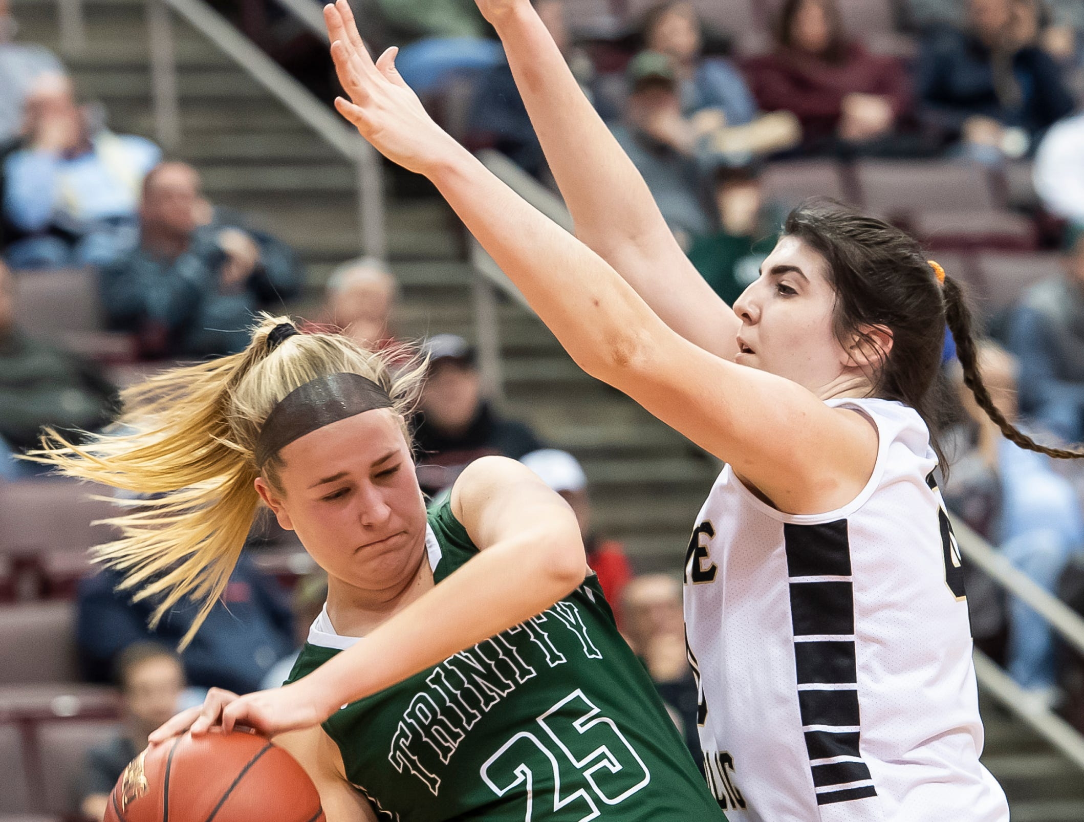 Delone Catholic's Bradi Zumbrum pressures Trinity's Lauren Trumpy during the District 3 3A girls championship game at the Giant Center in Hershey Wednesday, Feb. 27, 2019. The Squirettes fell 44-33.