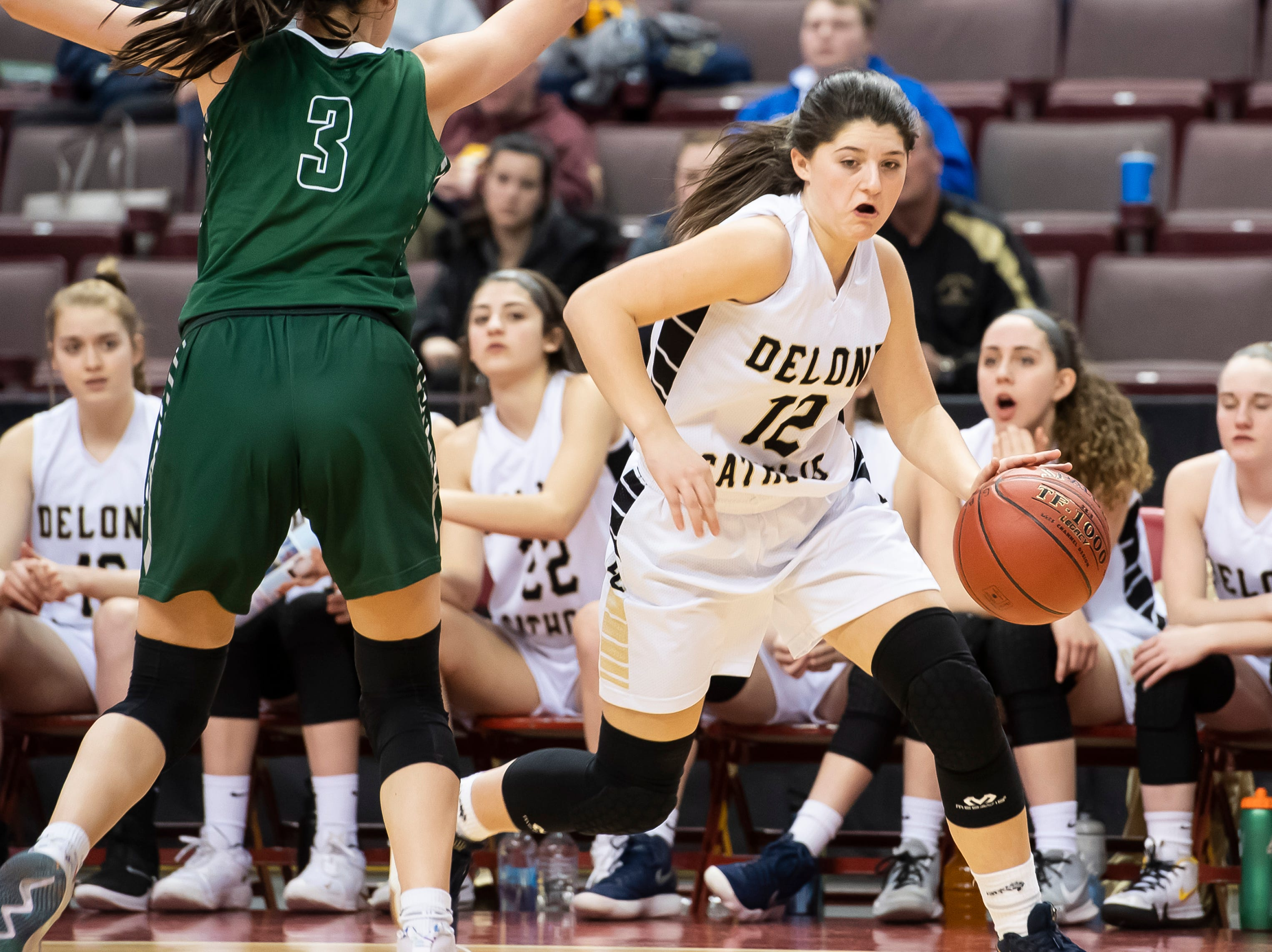 Delone Catholic's Giana Hoddinott dribbles around Trinity's Ava Stevenson during the District 3 3A girls championship game at the Giant Center in Hershey Wednesday, Feb. 27, 2019. Hoddinott lead the Squirettes with 10 points.