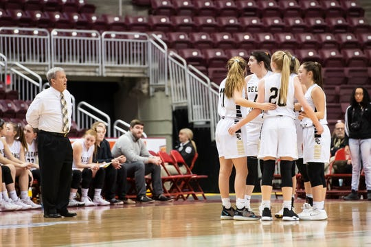 Delone Catholic head coach Gerry Eckenrode talks to his team as they come out of a timeout during the District 3 3A girls championship game against Trinity at the Giant Center in Hershey Wednesday, Feb. 27, 2019. The Squirettes fell 44-33.