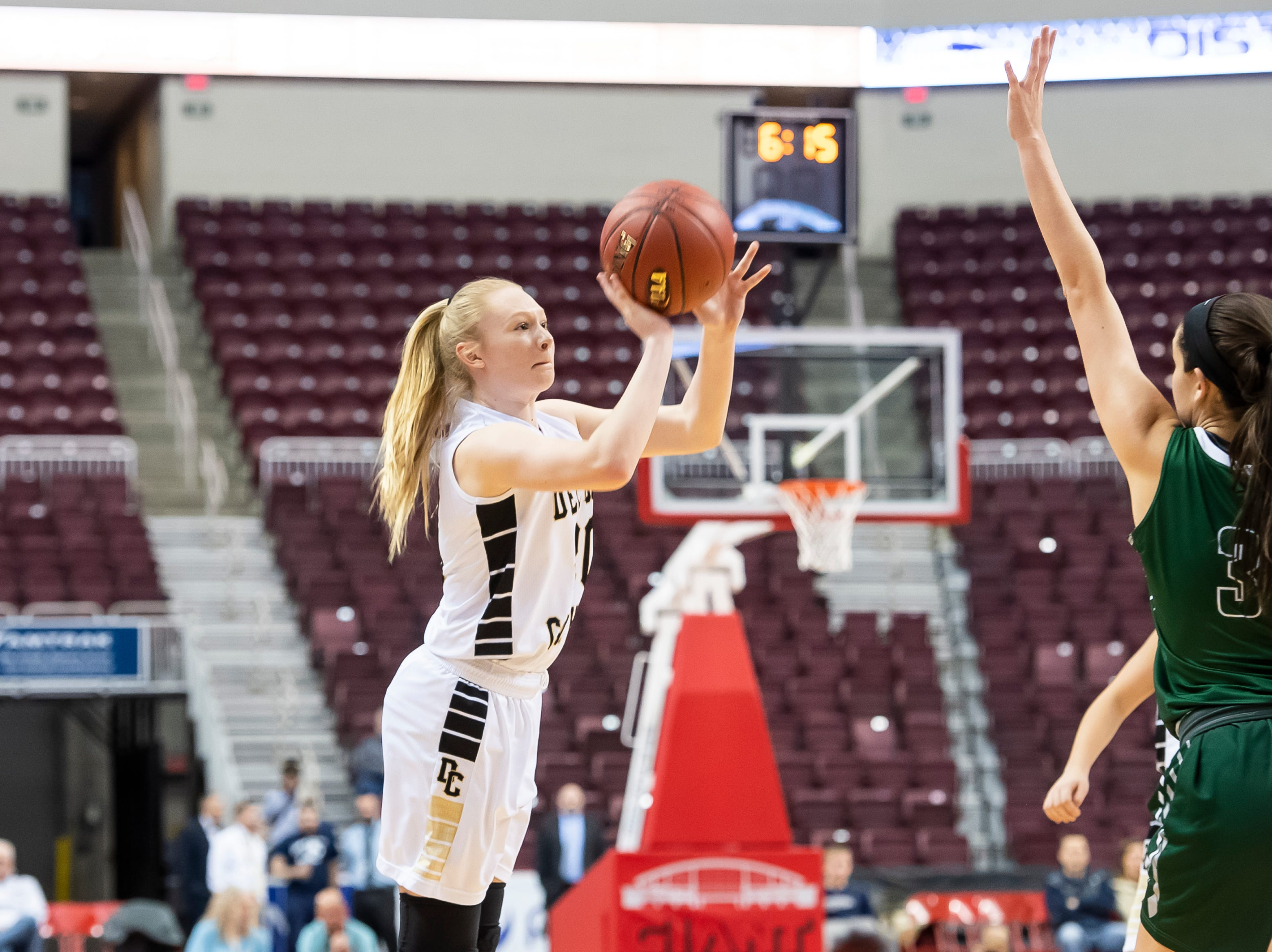 Delone Catholic's Brooke Lawyer takes a 3-point shot during the District 3 3A girls championship game against Trinity at the Giant Center in Hershey Wednesday, Feb. 27, 2019. The Squirettes fell 44-33.