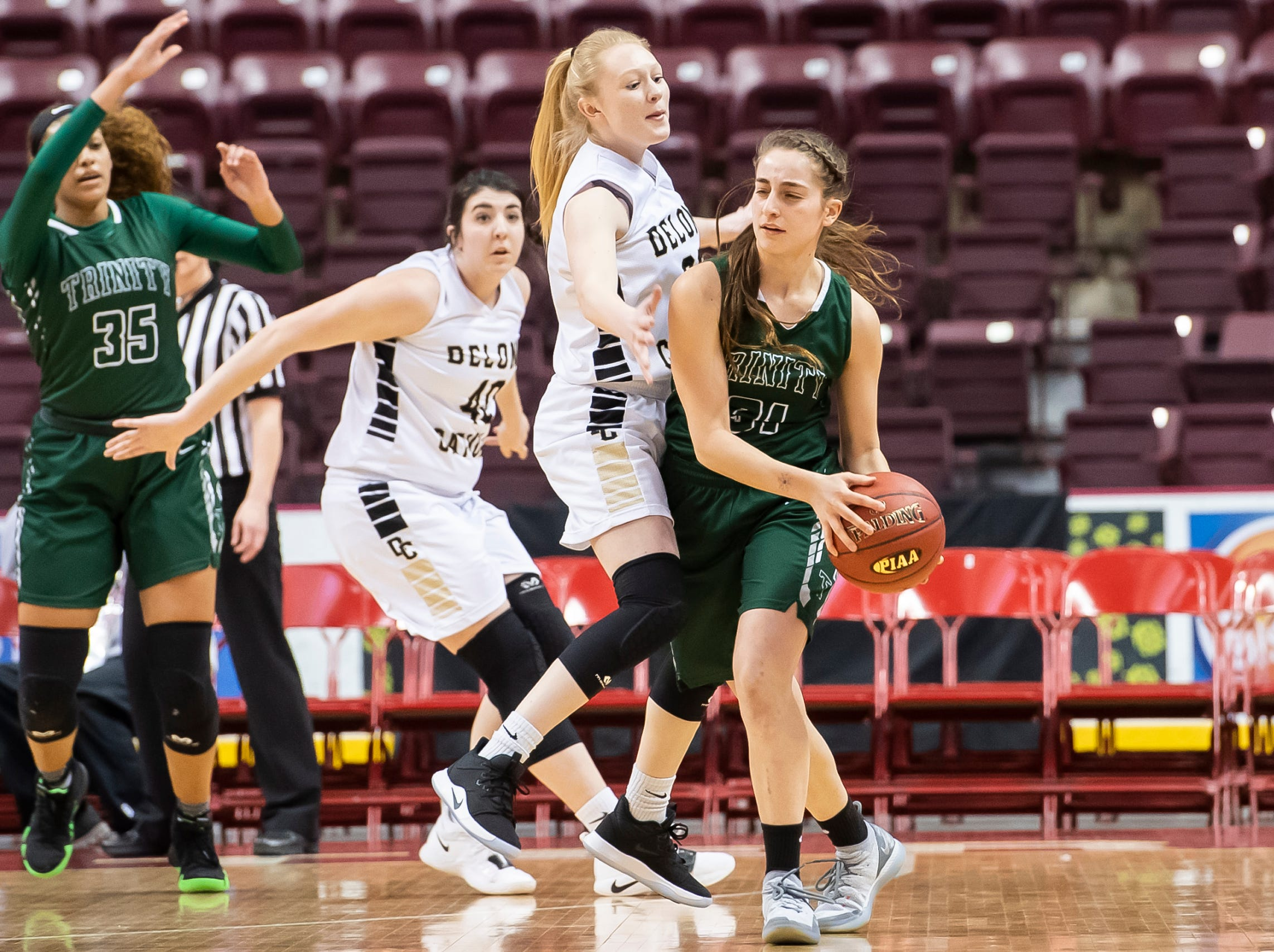 Delone Catholic's Brooke Lawyer pressures Trinity's Braylee Fetterolf during the District 3 3A girls championship game at the Giant Center in Hershey Wednesday, Feb. 27, 2019. The Squirettes fell 44-33.