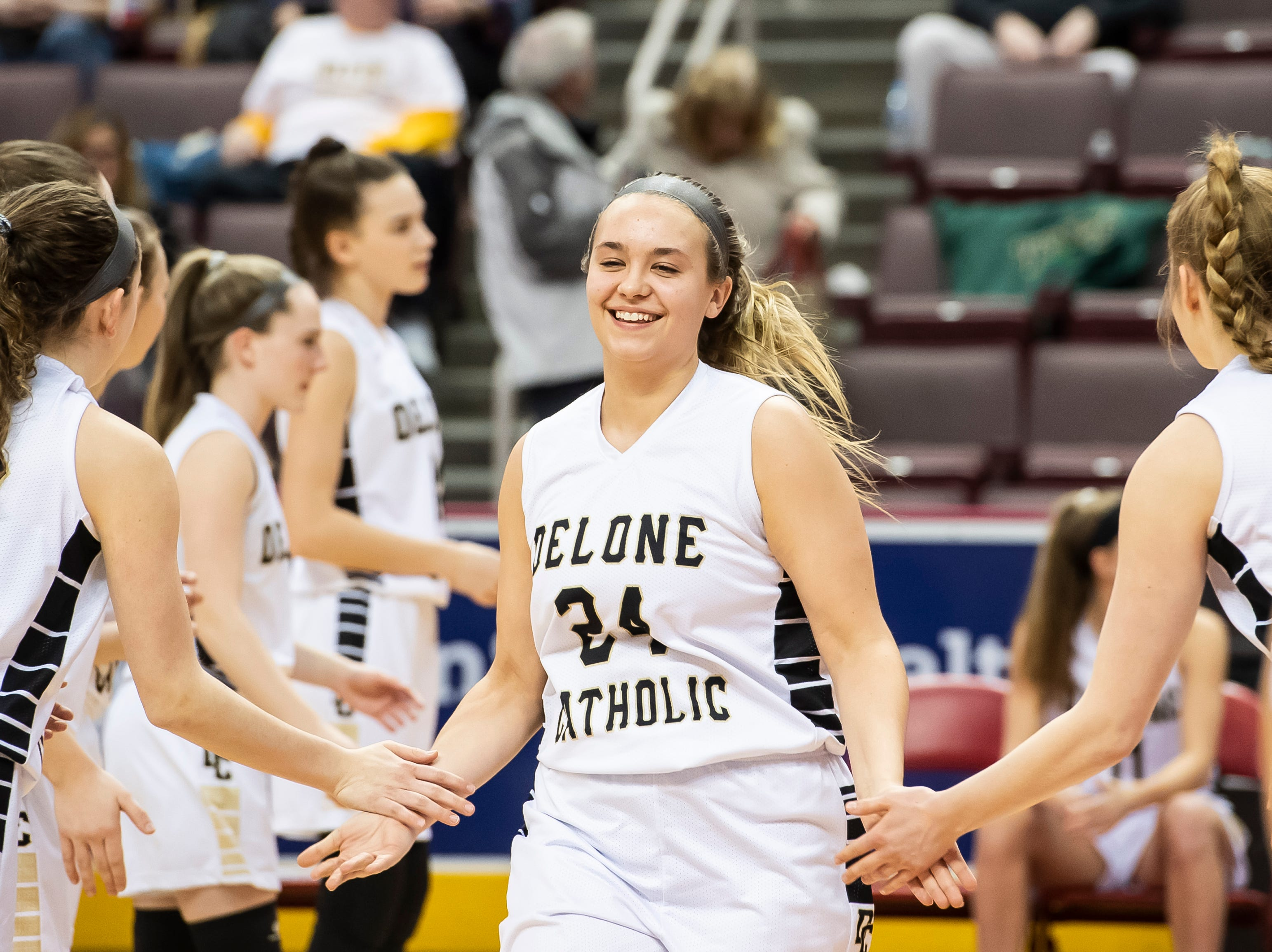 Delone Catholic's Colleen Anderson is introduced during the starting lineups before the District 3 3A girls championship game against Trinity at the Giant Center in Hershey Wednesday, Feb. 27, 2019. The Squirettes fell 44-33.