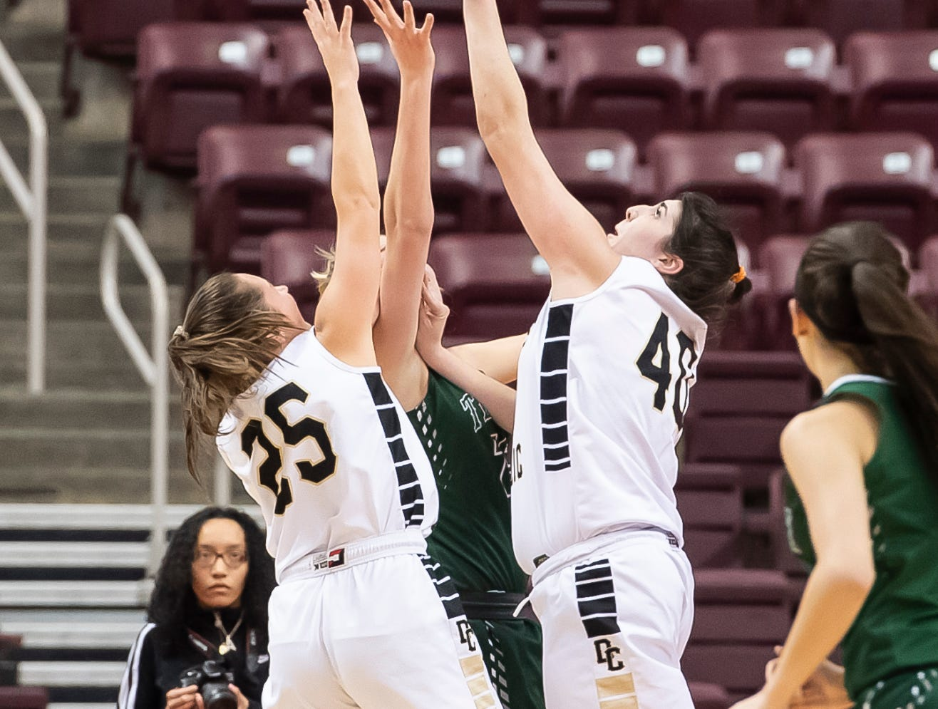 Delone Catholic's Bradi Zumbrum gets her fingers on a rebound during the District 3 3A girls championship game against Trinity at the Giant Center in Hershey Wednesday, Feb. 27, 2019. The Squirettes fell 44-33.