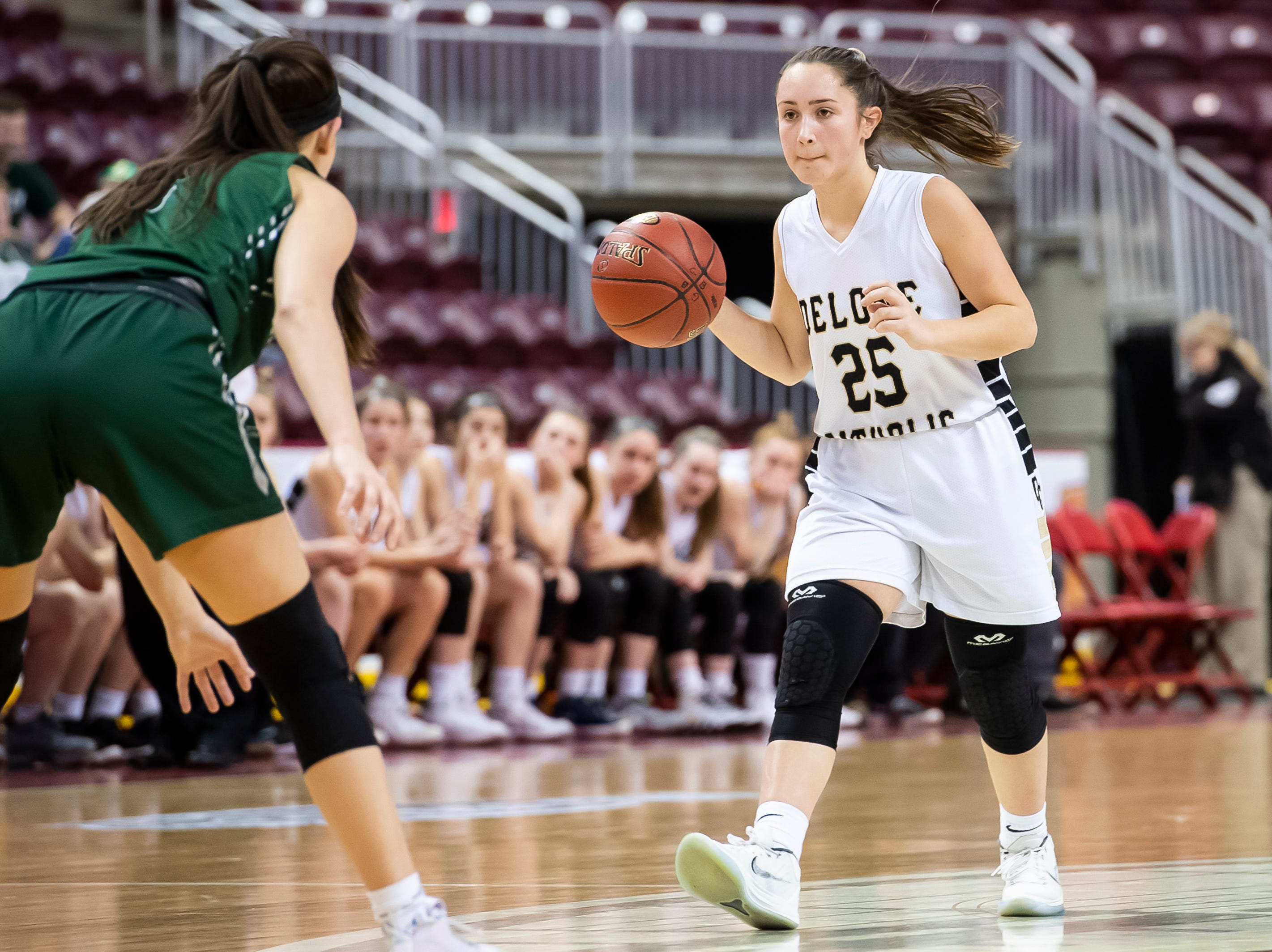 Delone Catholic's Camryn Felix moves down the court during the District 3 3A girls championship game against Trinity at the Giant Center in Hershey Wednesday, Feb. 27, 2019. The Squirettes fell 44-33.