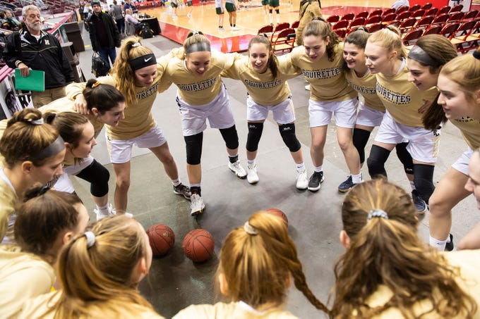 The Delone Catholic Squirettes huddle up prior to the District 3 3A girls championship game against Trinity at the Giant Center in Hershey Wednesday, Feb. 27, 2019. The Squirettes fell 44-33, but move on to the PIAA states tournament.