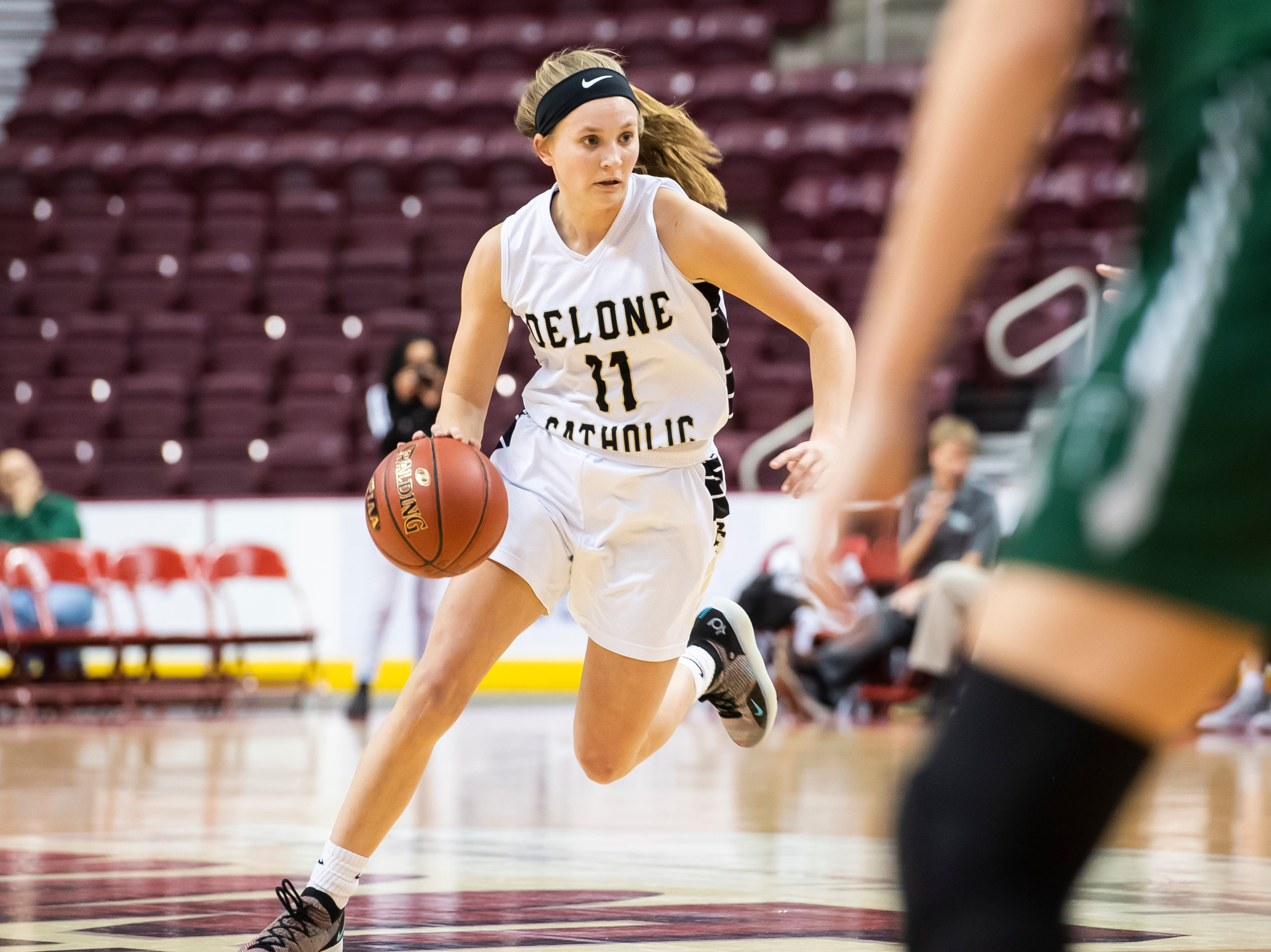 Delone Catholic's Riley Vingsen drives during the District 3 3A girls championship game against Trinity at the Giant Center in Hershey Wednesday, Feb. 27, 2019. The Squirettes fell 44-33.