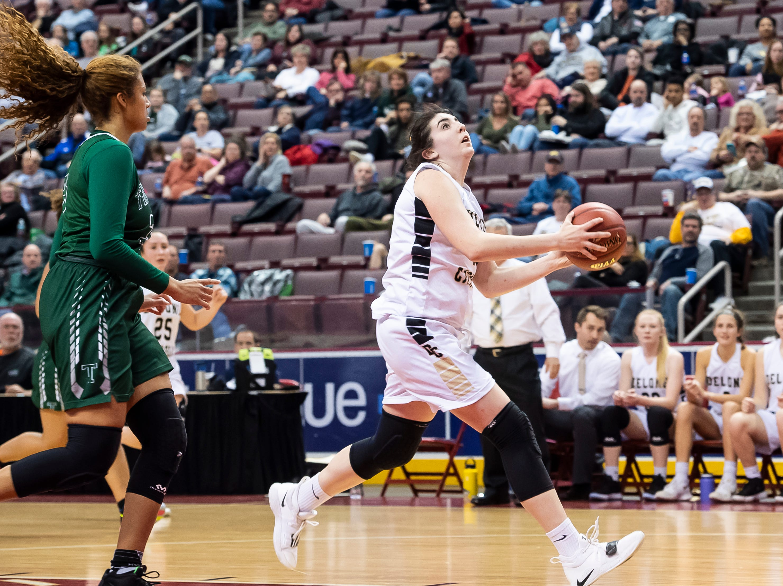 Delone Catholic's Bradi Zumbrum dribbles into the paint to shoot a layup during the District 3 3A girls championship game against Trinity at the Giant Center in Hershey Wednesday, Feb. 27, 2019. The Squirettes fell 44-33.
