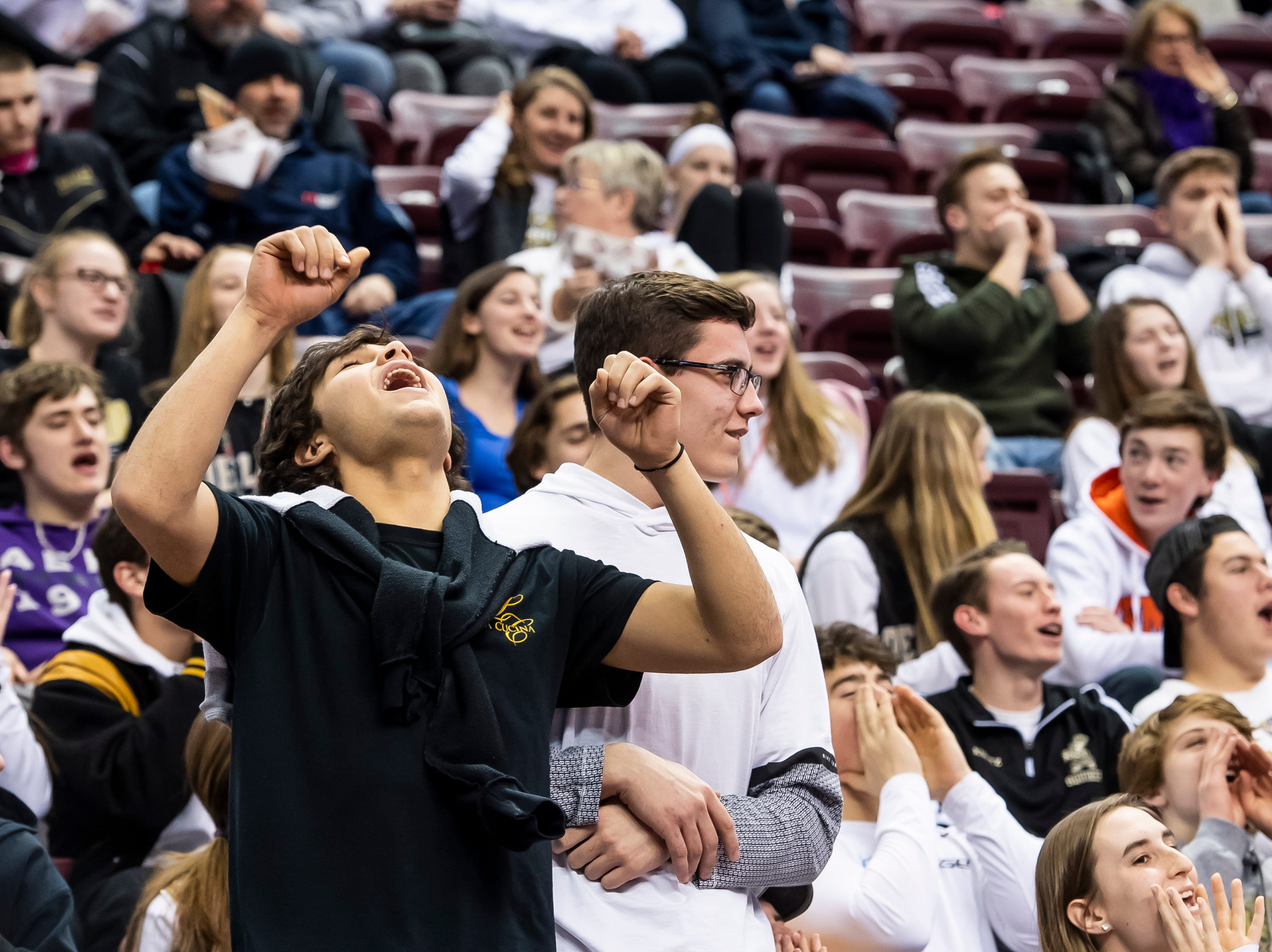 Delone Catholic fans chant during the District 3 3A girls championship game against Trinity at the Giant Center in Hershey Wednesday, Feb. 27, 2019. The Squirettes fell 44-33.