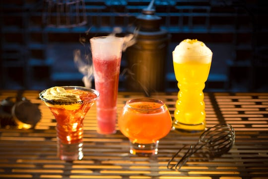 From left to right, alcoholic beverages: The Outer Rim, Bespin Fizz, Yub Nub, and Fuzzy Tauntaun can be found at Oga's Cantina inside Star Wars: Galaxy's Edge.