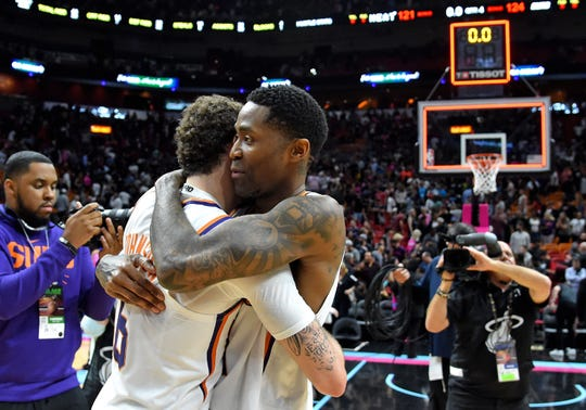 Tyler Johnson embraces guard Jamal Crawford, right, after the Suns snapped a 17-game losing streak with a victory over the Heat.