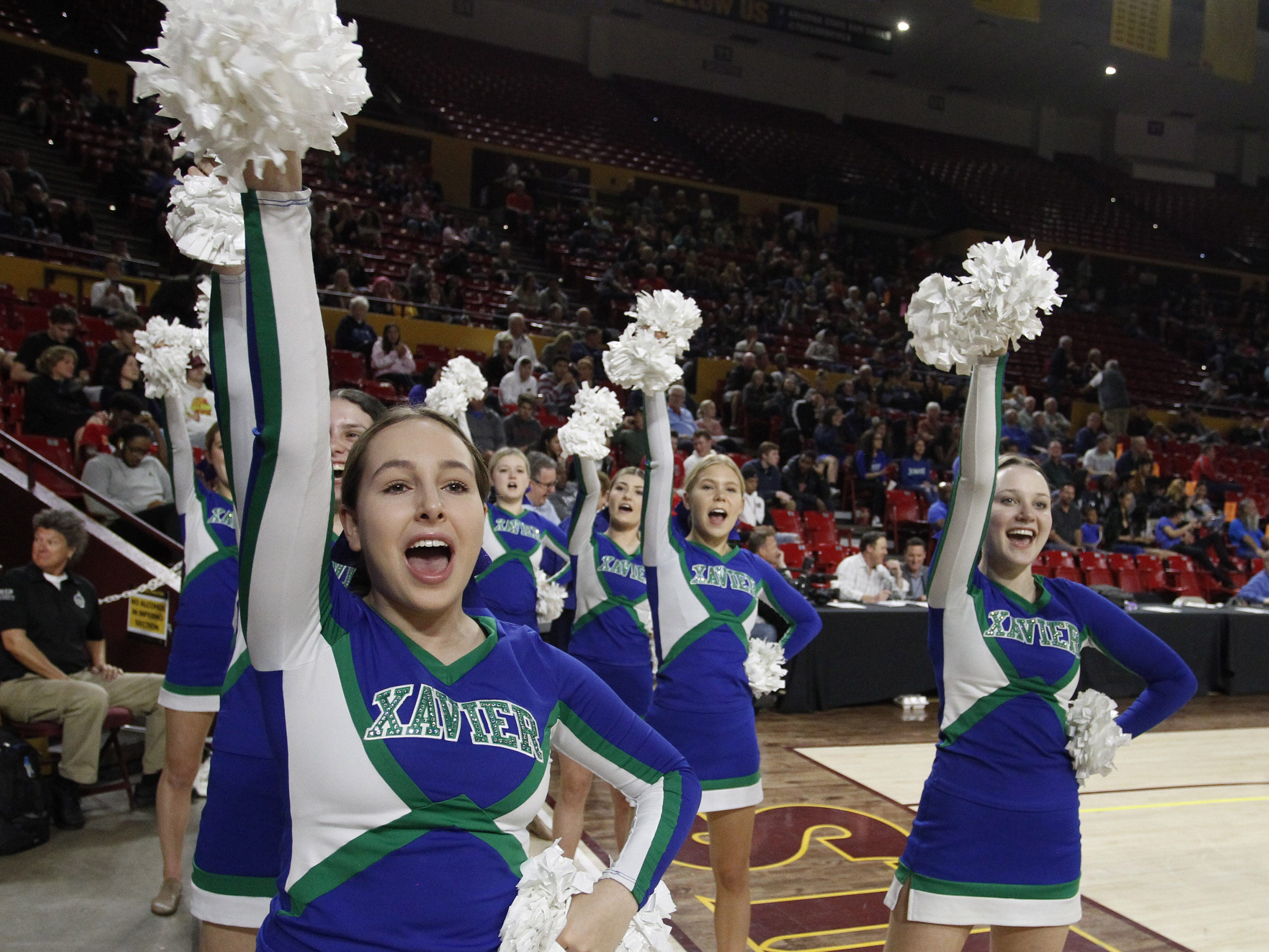 Xavier cheerleaders do their thing against Hamilton during the 6A Girls State Championship at Wells Fargo Arena in Tempe Tuesday, Feb 26, 2019.