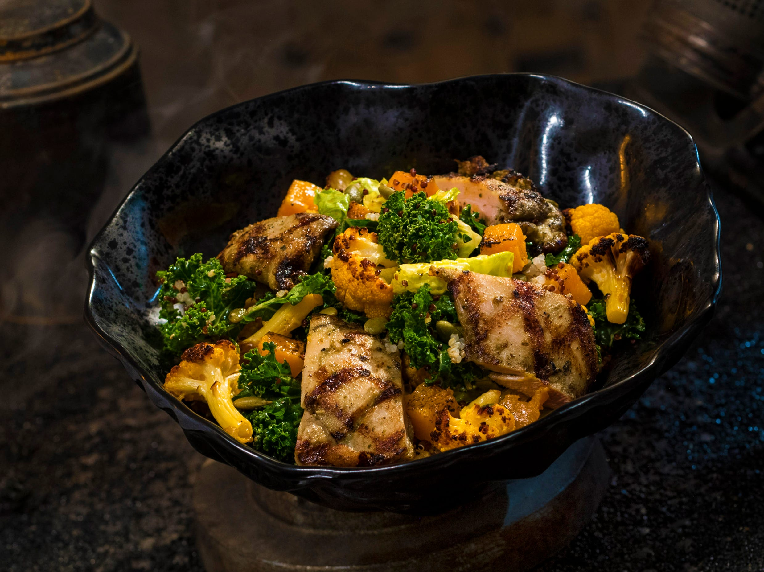 The Oven-roasted Tip Yip, found at Docking Bay 7 Food and Cargo inside Star Wars: Galaxy's Edge, features roasted chicken with mixed greens, roasted vegetables, quinoa and pumpkin seeds with a creamy green curry ranch dressing.