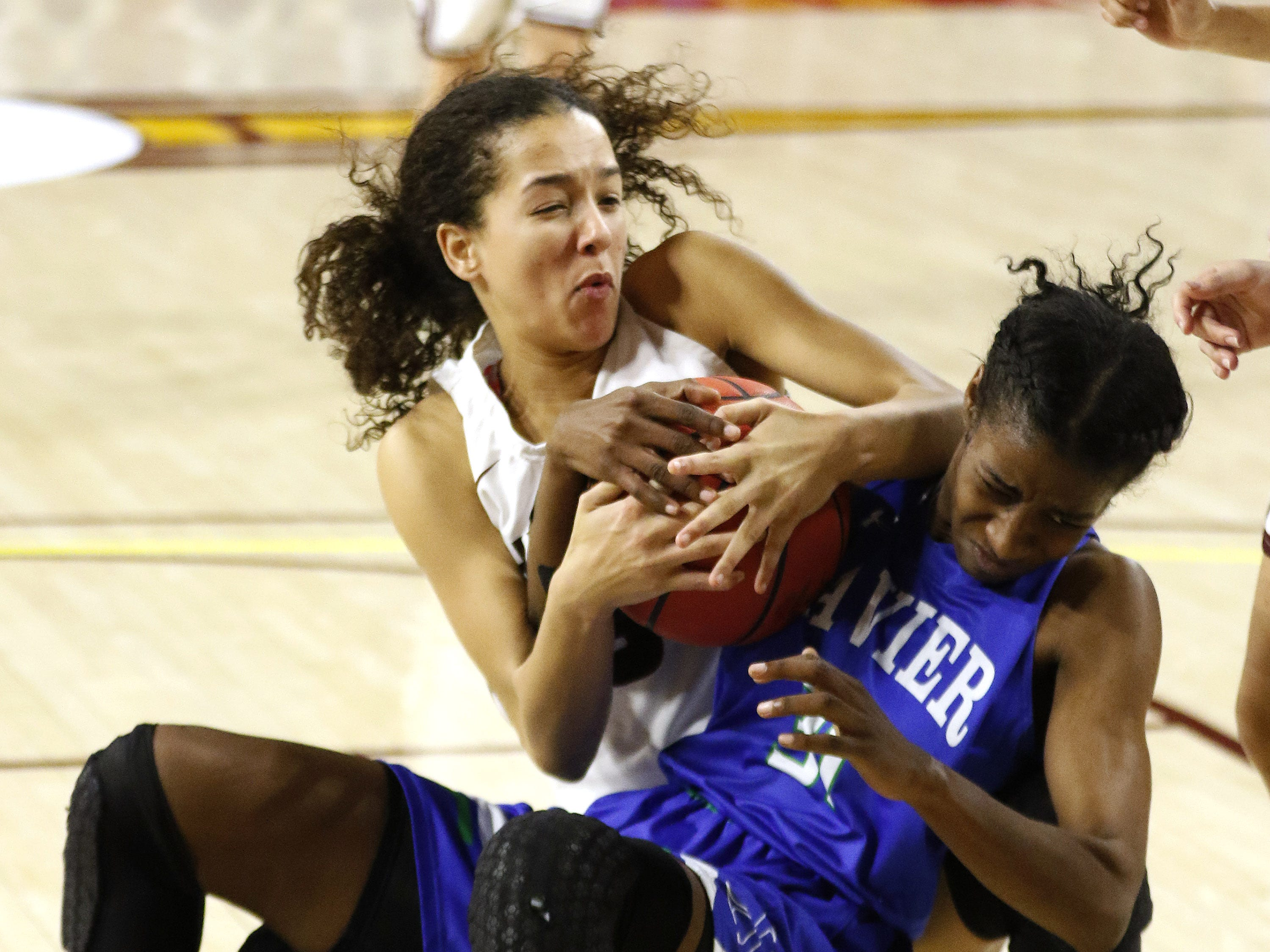 Hamilton's Samara Curry (33) battles for the ball with Xavier's Paris Rasheed-MooreÊ(31 ) during the 6A Girls State Championship at Wells Fargo Arena in Tempe Tuesday, Feb 26, 2019.