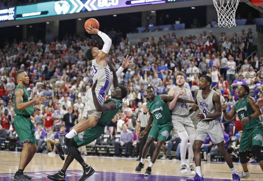 Grand Canyon's Carlos Johnson attempts to score against Eastern New Mexico Wednesday, Feb. 27., 2019, at Grand Canyon University Arena.