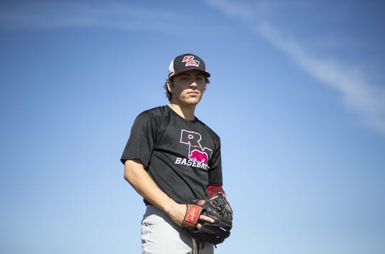 Red Mountain's Kai Murphy stands alone on the baseball field, but his father Pat Murphy is always behind him.