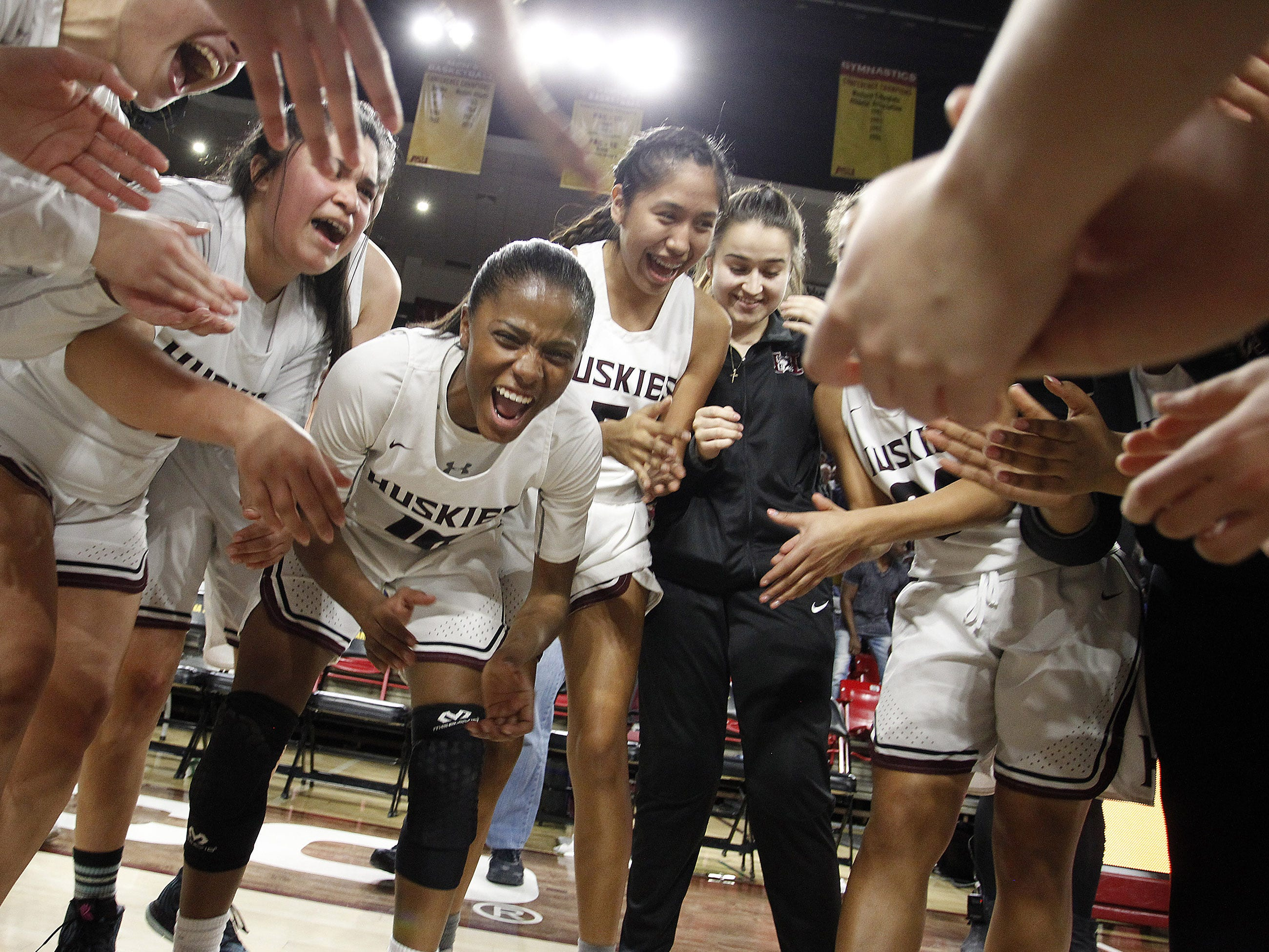 Hamilton players celebrate their 45-33 win over Xavier in the 6A Girls State Championship at Wells Fargo Arena in Tempe Tuesday, Feb 26, 2019.