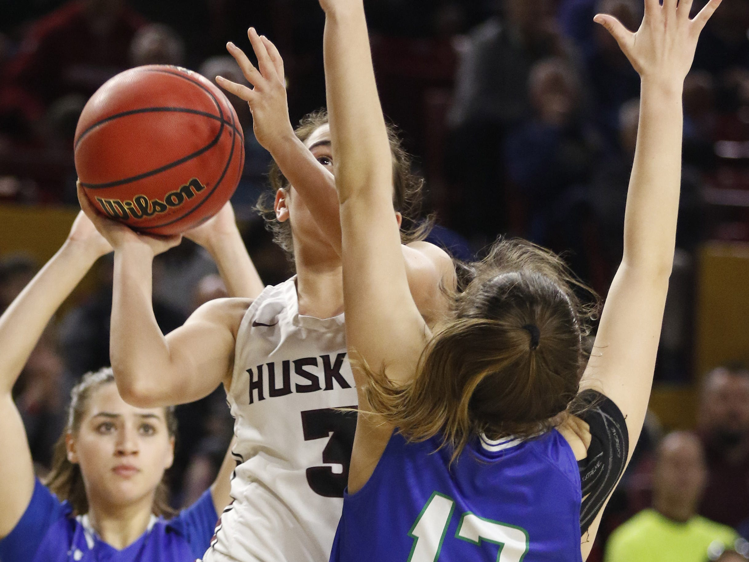 Hamilton's Graciela Roybal (3) eyes the basket as she drives to the lane against Xavier's Addie PutnamÊ(12) during the 6A Girls State Championship at Wells Fargo Arena in Tempe Tuesday, Feb 26, 2019.