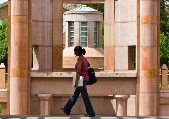 A student crosses ASU's Tempe campus in 2008, in front of the entrance to Hayden Library.