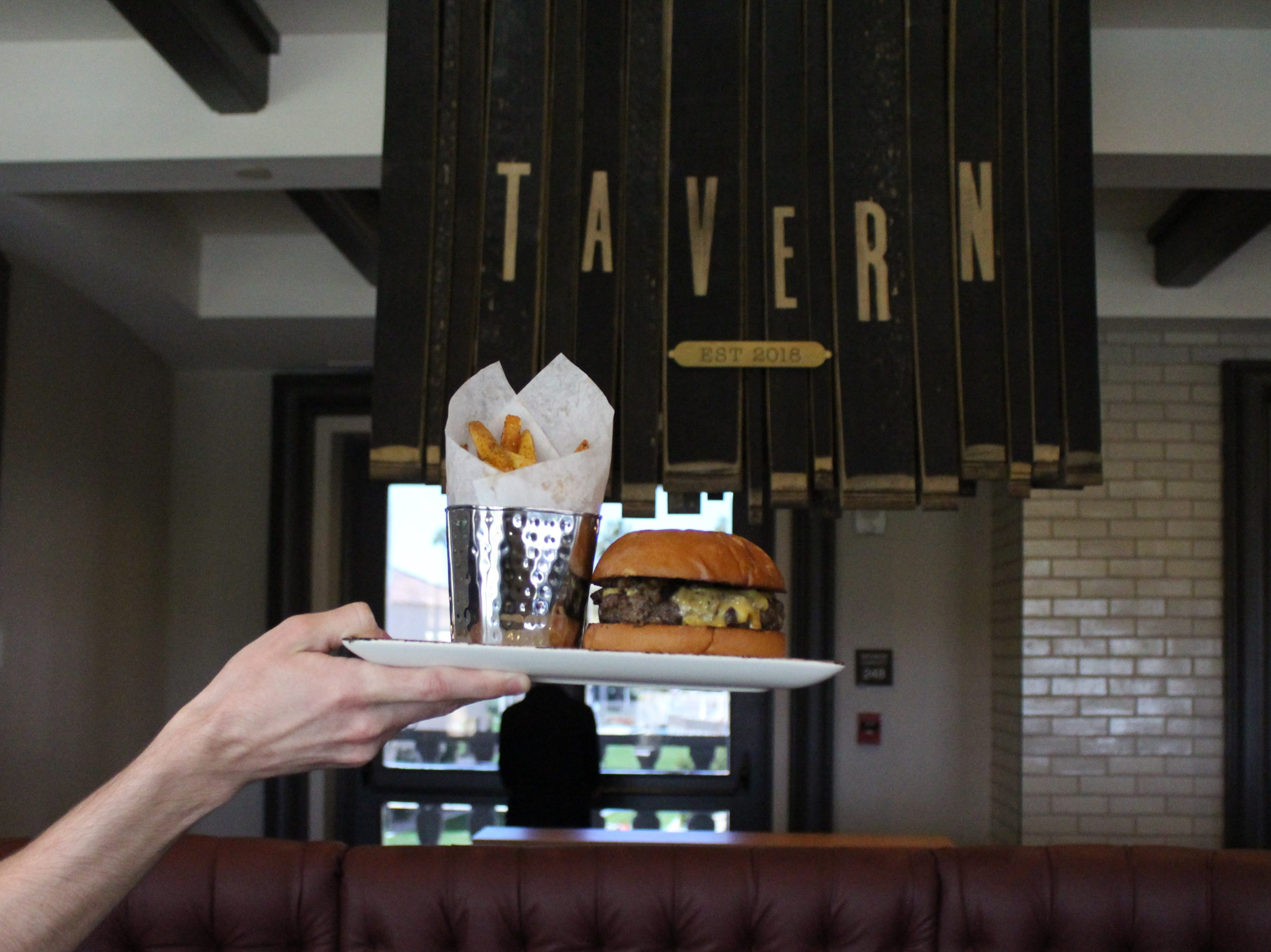 The Phoenician Tavern serves elevated American comfort food including burgers, sandwiches and mac and cheese.