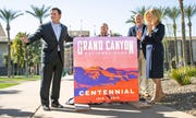Gov. Doug Ducey, left, helps unveil a new sign marking the 100th birthday of the Grand Canyon during a ceremony in Wesley Bolin Memorial Plaza at the Capitol in Phoenix, February 27, 2019.