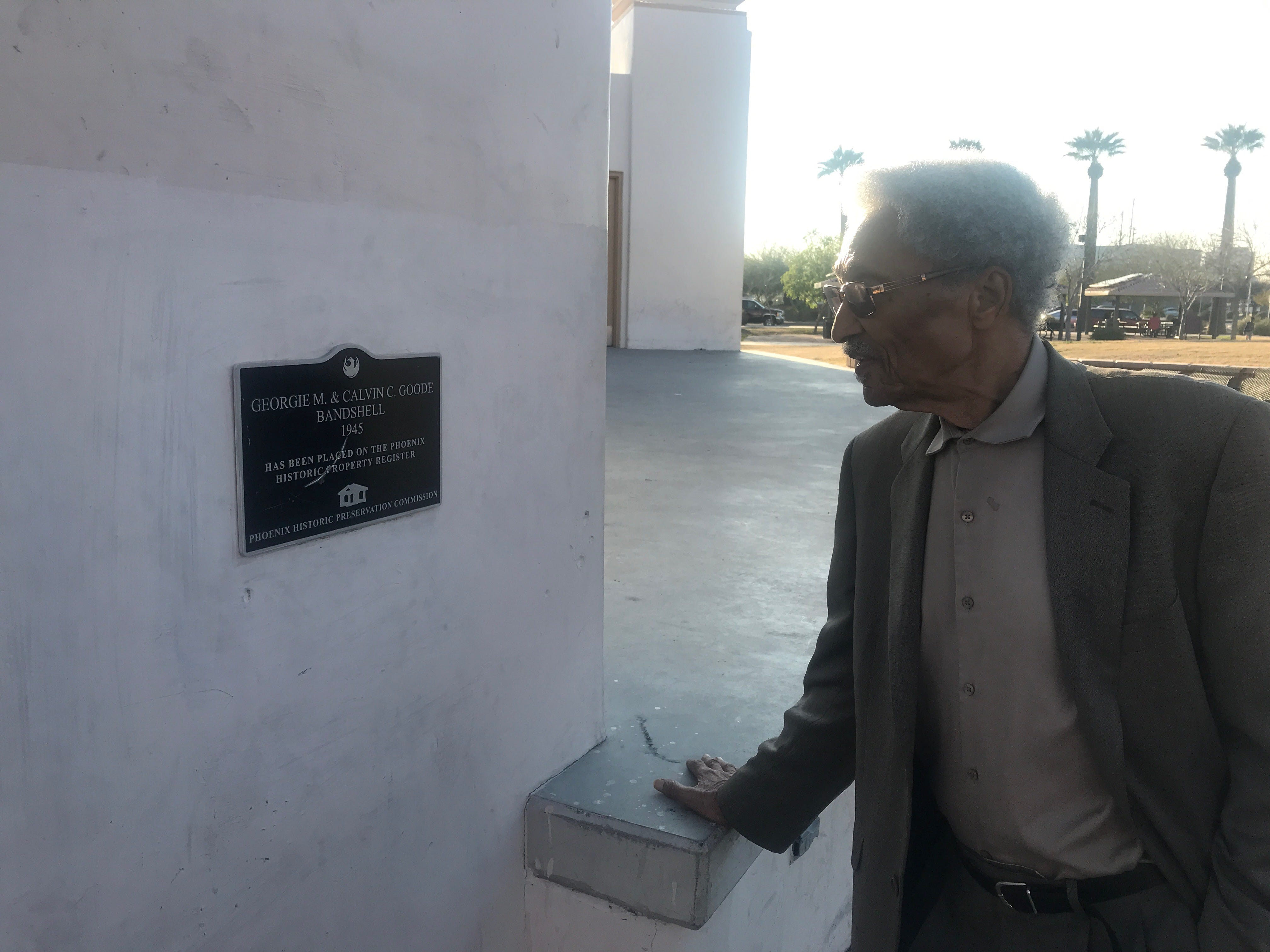 Calvin Goode looks at the amphitheater sign bearing his name on Wednesday, Feb. 27, 2019.