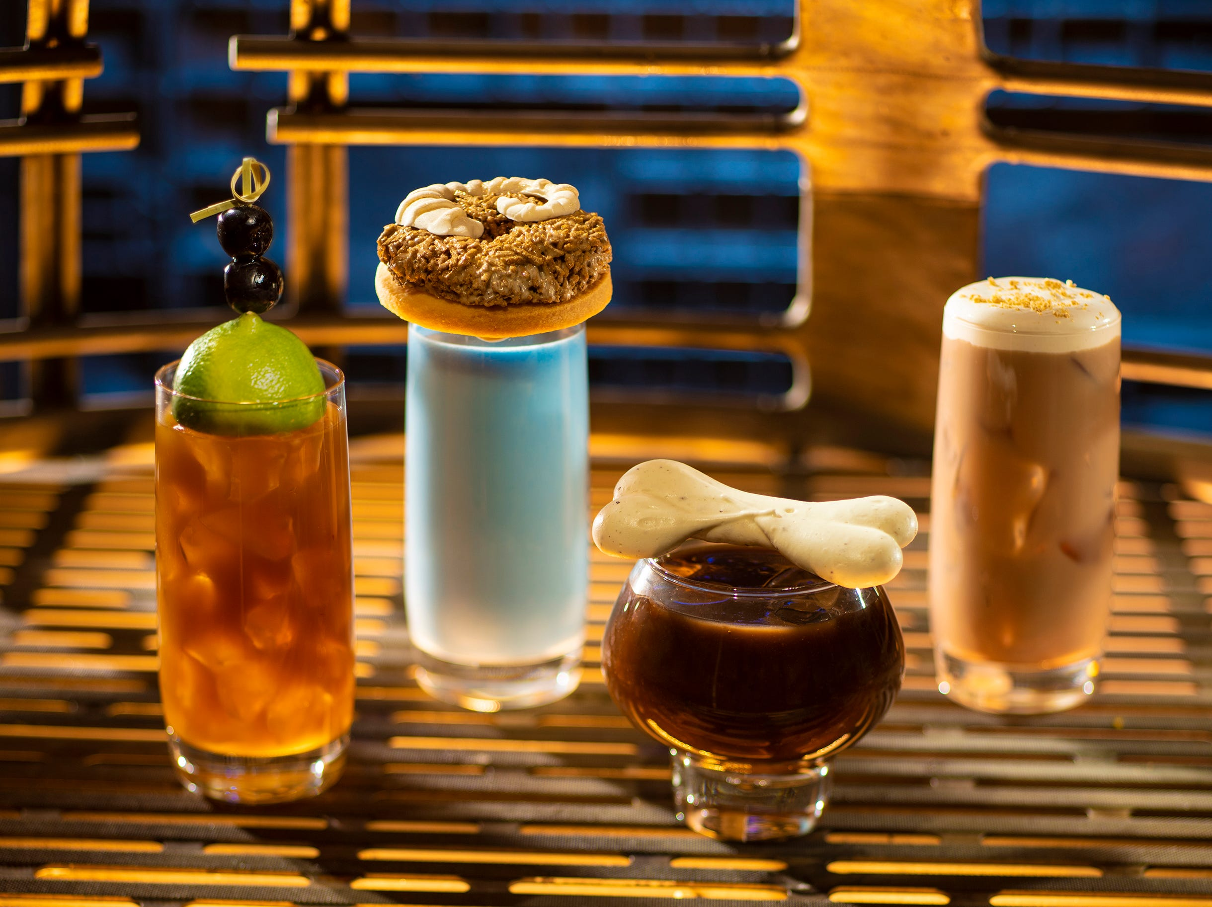 From left to right: Moogan Tea, Blue Bantha, Bloody Rancor (contains alcohol) and the Black Spire Brew can be found at Oga's Cantina inside Star Wars: Galaxy's Edge.