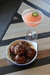 Beignets and a smoked watermelon cocktail at The Phoenician Tavern.