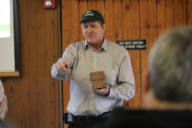 """Soil health specialist James Hoorman demonstrates how cover crops and """"no-till"""" methods can improve the soil structure for farms at an Ottawa SWD workshop on Thursday."""