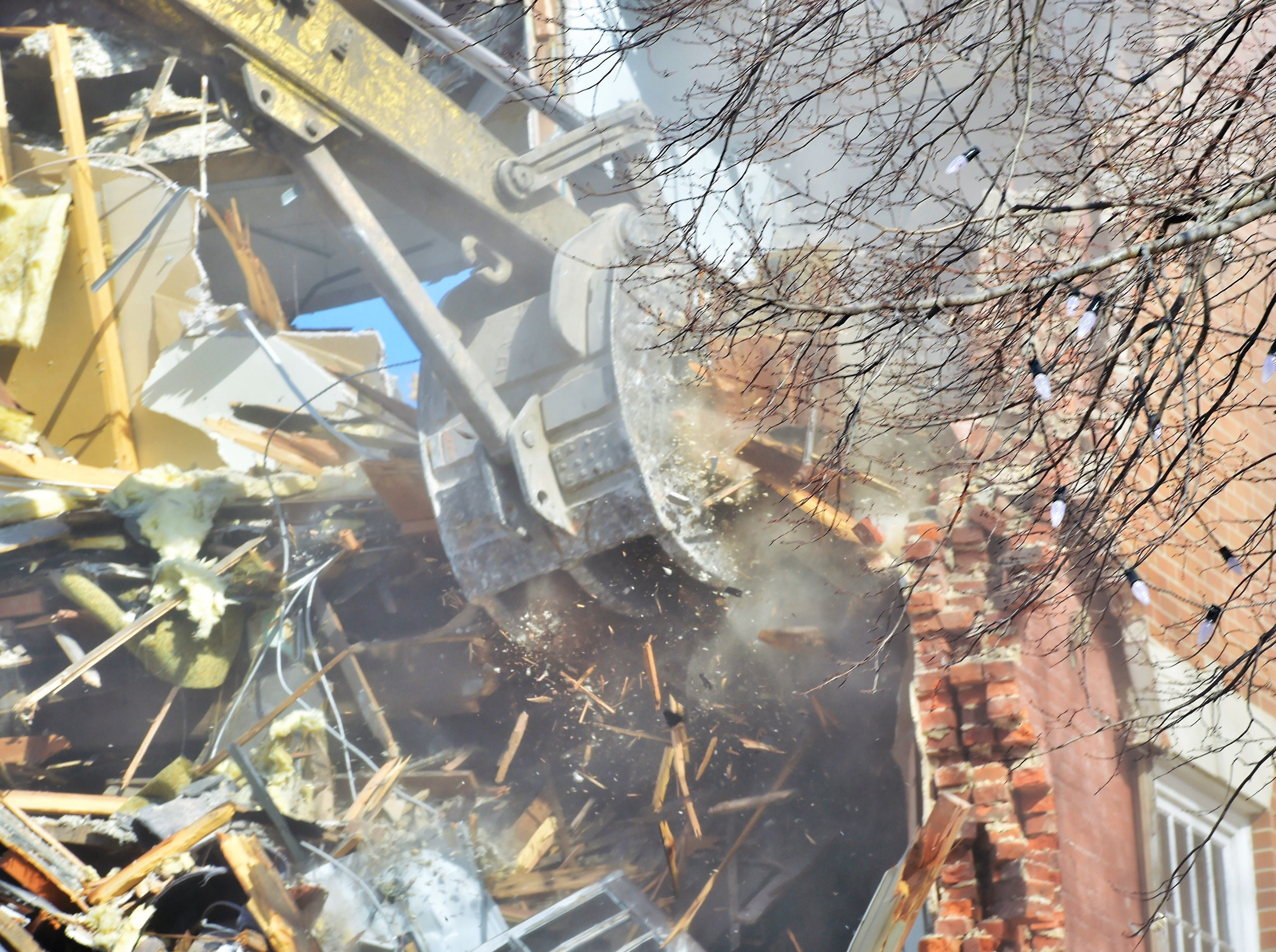 Demolition of the Courtside Professional Building in Chambersburg was underway Feb. 28. The three-story section was being demolished first. The demolition will make room for a new judicial center.