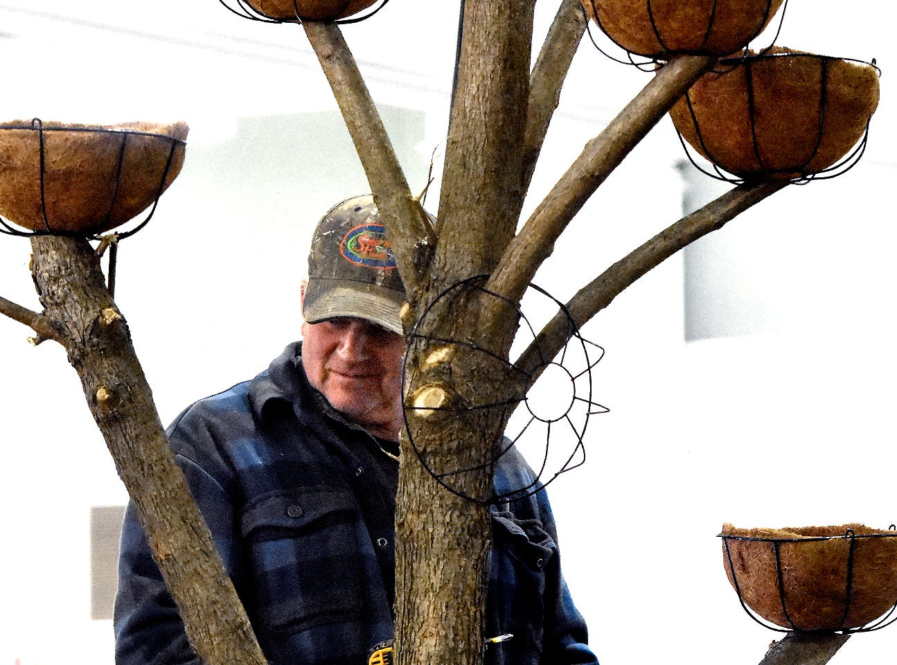 """Steve Bupp, co-owner of Cross Creek Farm in Codorus Township, creates a flower tree at the PA Garden Show of York Wednesday, Feb. 27, 2019. The show, themed """"Flowers on Parade,"""" is in Memorial Hall at the York Expo Center March 1-3. Hours Friday and Saturday are 10 a.m. to 8 p.m., and Sunday 10 a.m. to 5 p.m. Admission for adults is $10. Children are free with multi-day passes and and senior discounts offered. Bill Kalina photo"""