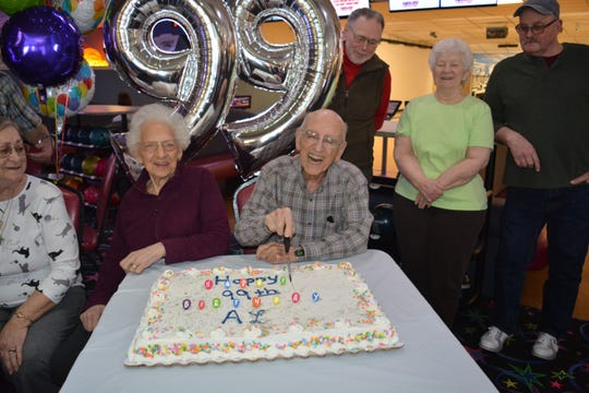 Al Libasci cut his cake to celebrate his 99th birthday. He then went out and rolled a 155 game at Laser Alleys. Seated at the table with Al is his wife Zee.