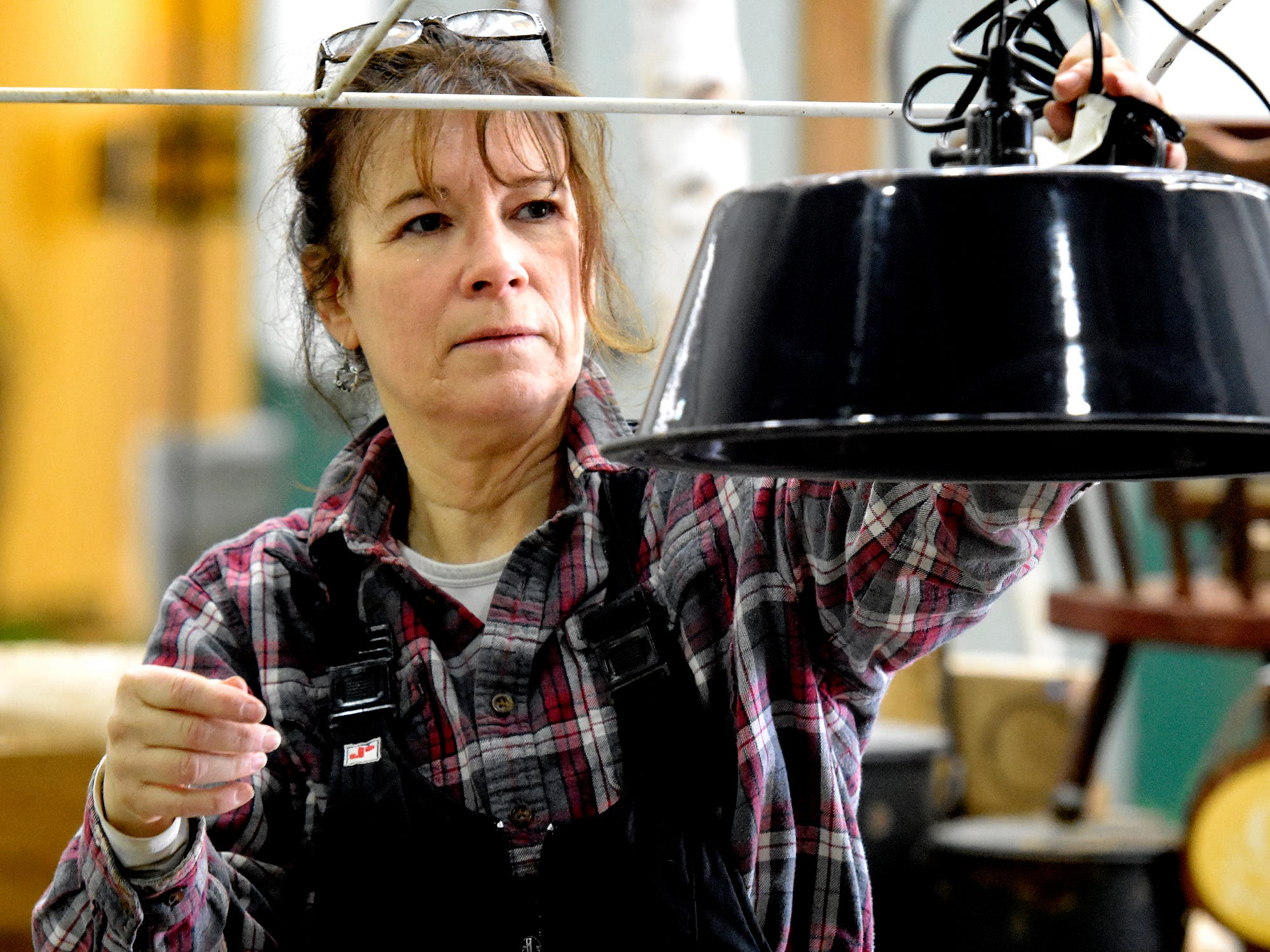 """Carolyn Bupp, co-owner of Cross Creek Farm in Codorus Township, prepares the business's exhibit at the PA Garden Show of York Wednesday, Feb. 27, 2019. The show, themed """"Flowers on Parade,"""" is in Memorial Hall at the York Expo Center March 1-3. Hours Friday and Saturday are 10 a.m. to 8 p.m., and Sunday 10 a.m. to 5 p.m. Admission for adults is $10. Children are free with multi-day passes and and senior discounts offered. Bill Kalina photo"""