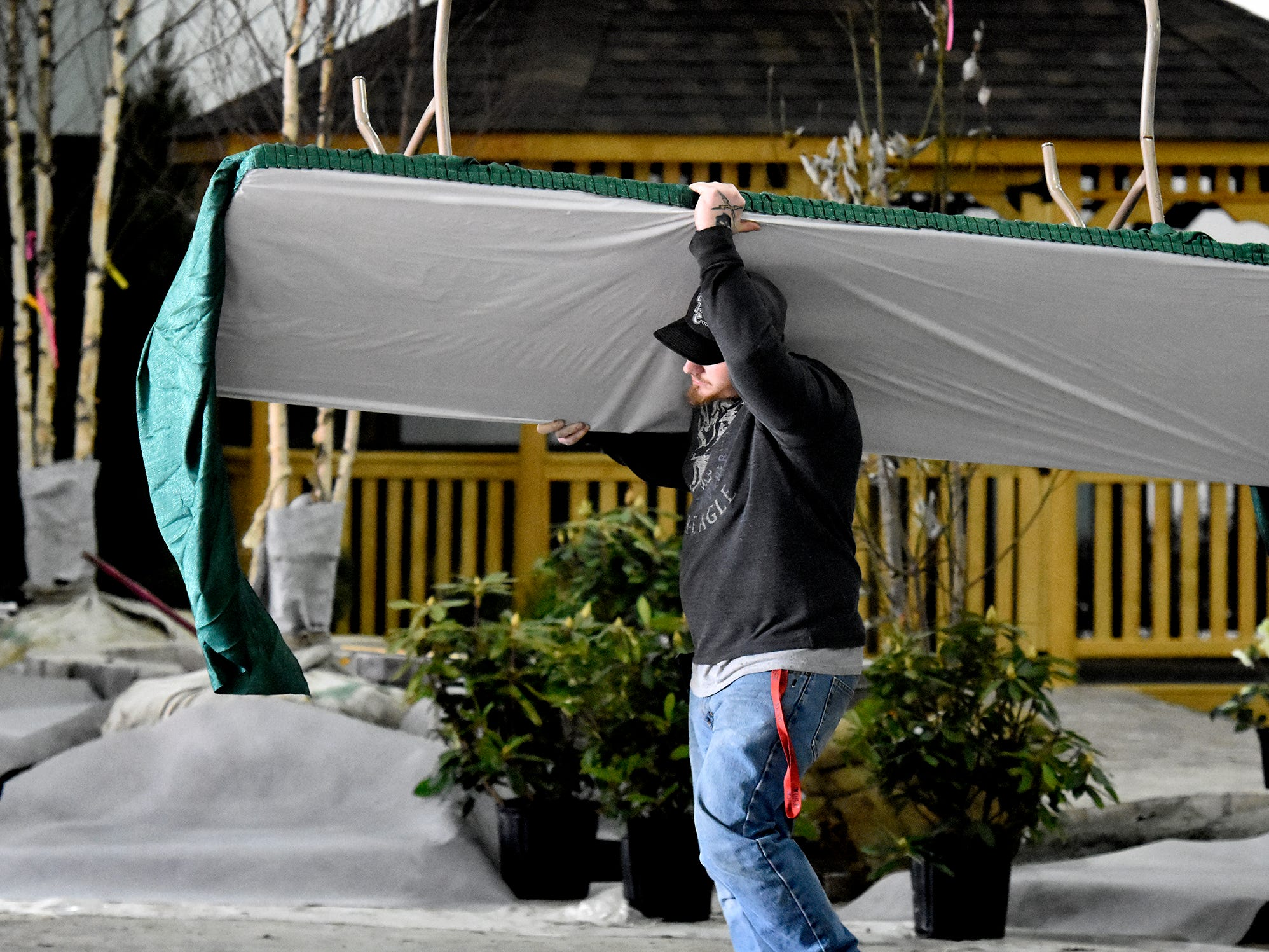 """Workers prepare for the PA Garden Show of York at Memorial Hall at the York Expo Center Wednesday, Feb. 27, 2019. The show, themed """"Flowers on Parade,"""" runs Friday and Saturday 10 a.m. to 8 p.m., and Sunday 10 a.m. to 5 p.m. Admission for adults is $10. Children are free with multi-day passes and and senior discounts offered. Bill Kalina photo"""