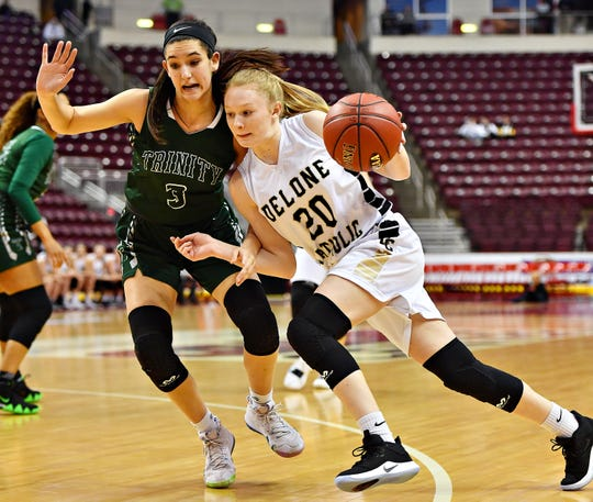 Delone Catholic's Brooke Lawyer, right, advances the ball while Trinity's Ava Stevenson defends during District 3, Class 3-A girls' basketball championship action at Giant Center in Hershey, Wednesday, Feb. 27, 2019. Dawn J. Sagert photo