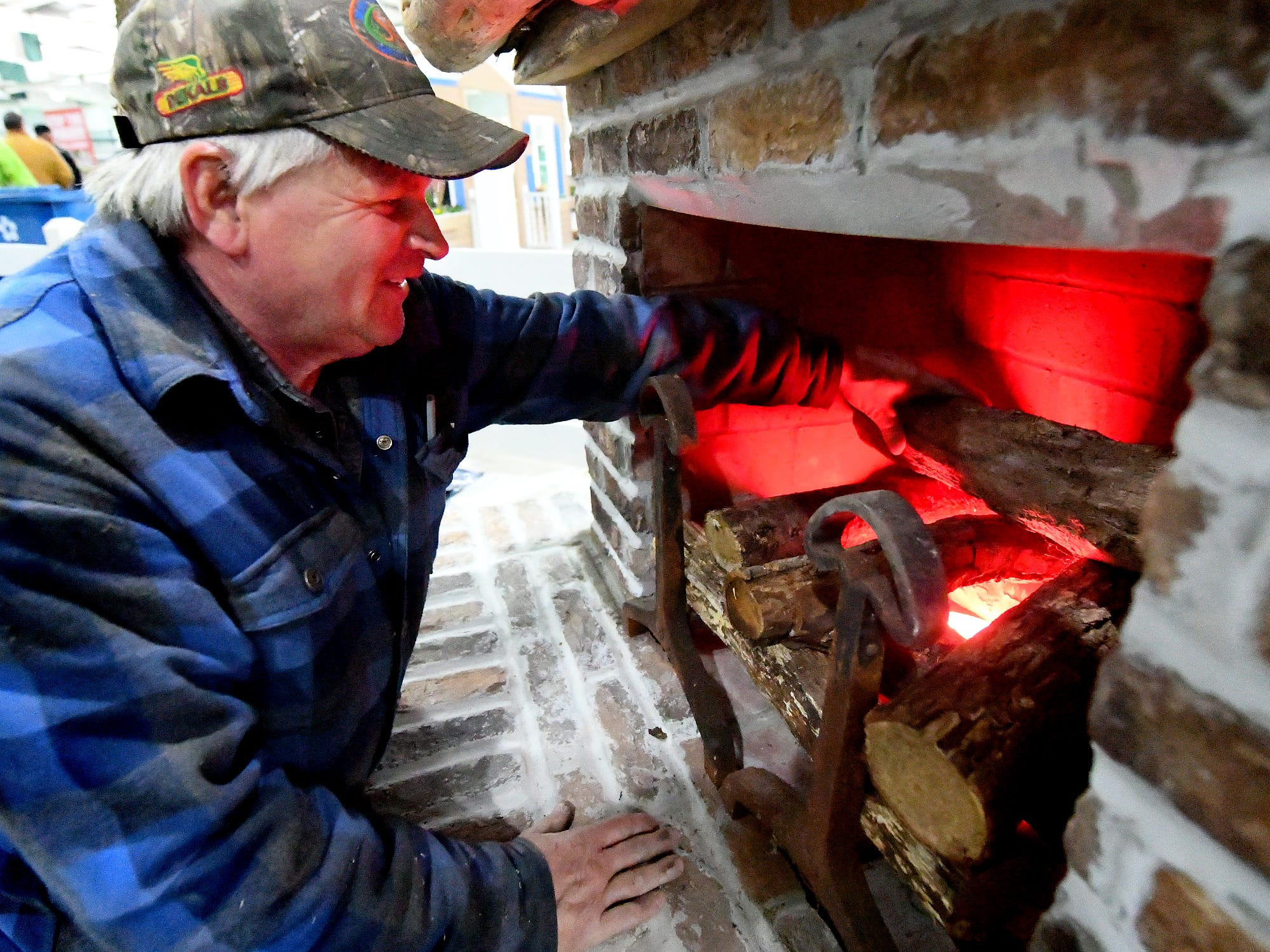 """Steve Bupp, co-owner of Cross Creek Farm in Codorus Township, prepares a portion of the company's exhibit at the PA Garden Show of York Wednesday, Feb. 27, 2019. The show, themed """"Flowers on Parade,"""" is in Memorial Hall at the York Expo Center March 1-3. Hours Friday and Saturday are 10 a.m. to 8 p.m., and Sunday 10 a.m. to 5 p.m. Admission for adults is $10. Children are free with multi-day passes and and senior discounts offered. Bill Kalina photo"""