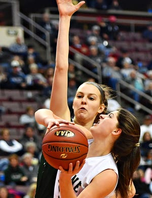 Delone Catholic sophomore Giana Hoddinott, seen here playing defense in a file photo, is the Squirettes' leading scorer this season at 16 points per game.