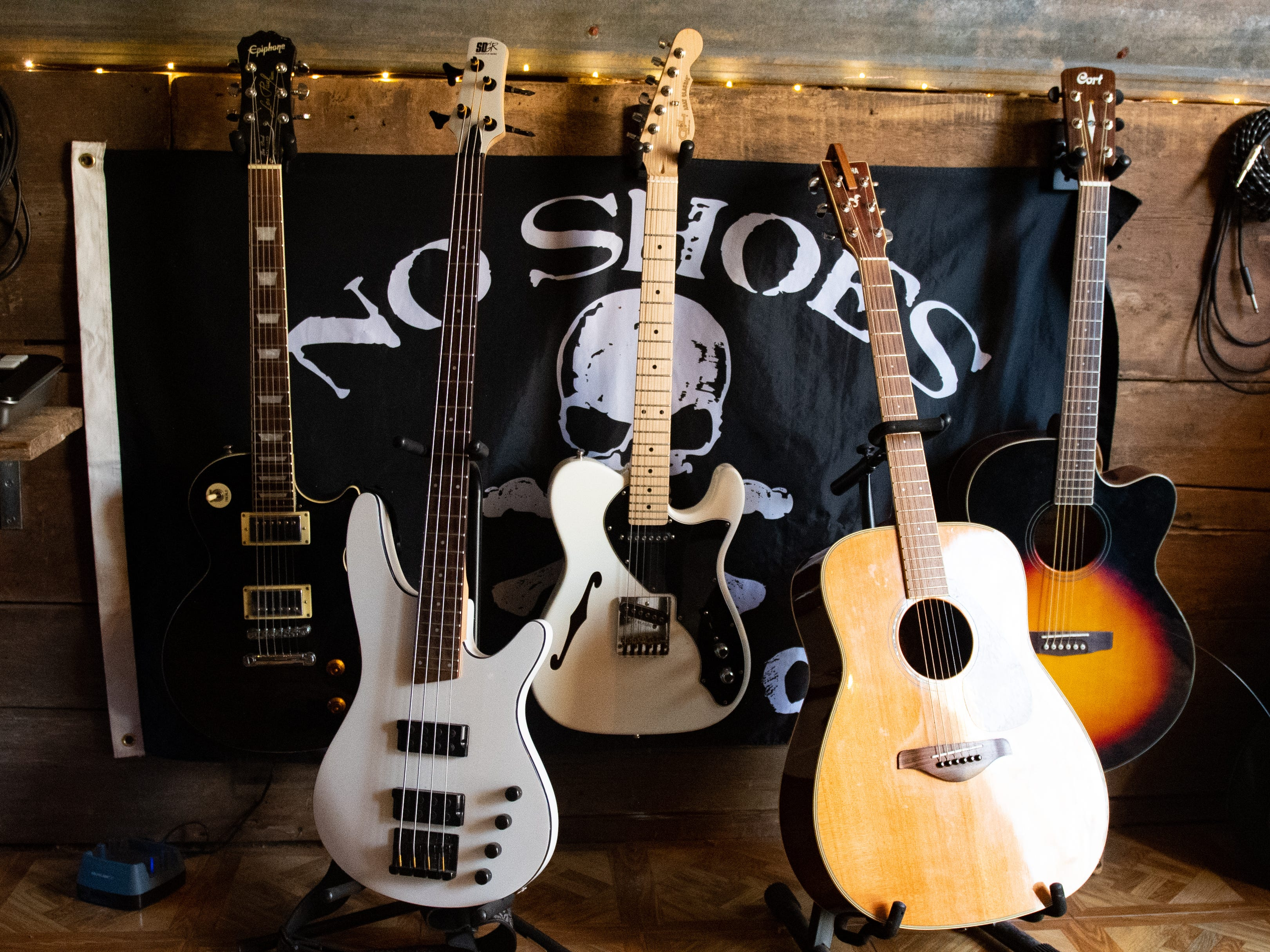 """Guitars wait to be played inside of """"Crooked Coop Records."""" Jake Puliti, an """"American Idol"""" hopeful whose audition is scheduled to air March 10, said he and his friends keep plenty of guitars within reach for when new riffs come to mind."""