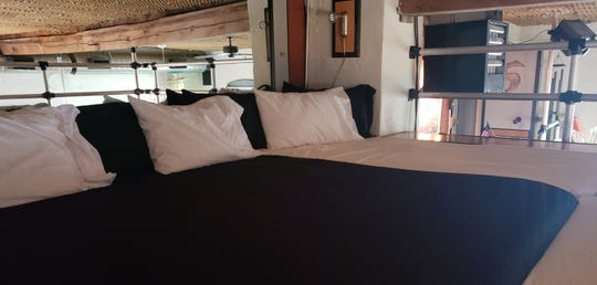 """The 10-person bed inside the loft of the """"grand suite"""" at Bube's Brewery. The third floor of the Victorian hotel is home to 8 speciality themed rooms and the suite."""