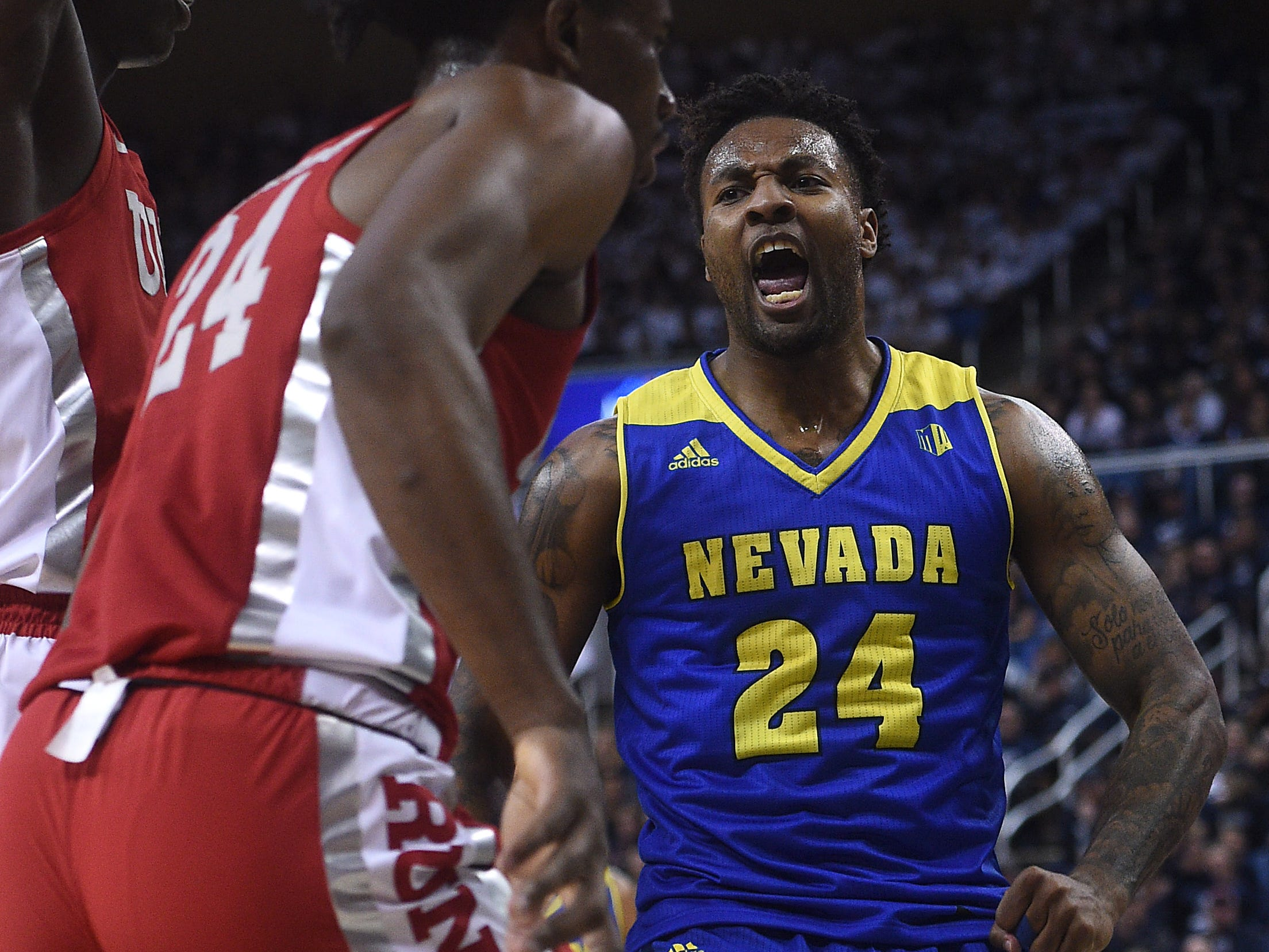 Nevada's Jordan Caroline reacts after scoring while taking on UNLV during their basketball game at Lawlor Events Center in Reno on Feb. 27, 2019.