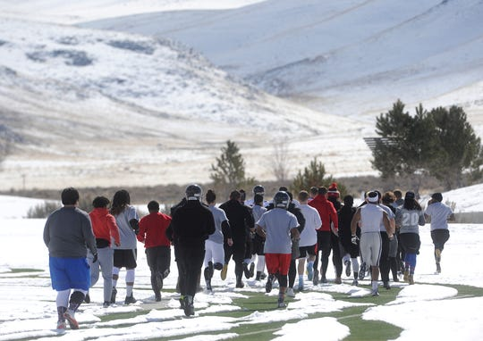 Players for the new Reno Express indoor football team run laps during practice at Golden Eagle Regional Park in Reno on Feb. 23, 2019.
