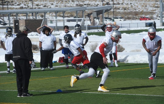 Players for the new Reno Express indoor football team run drills during practice at Golden Eagle Regional Park in Reno on Feb. 23, 2019.