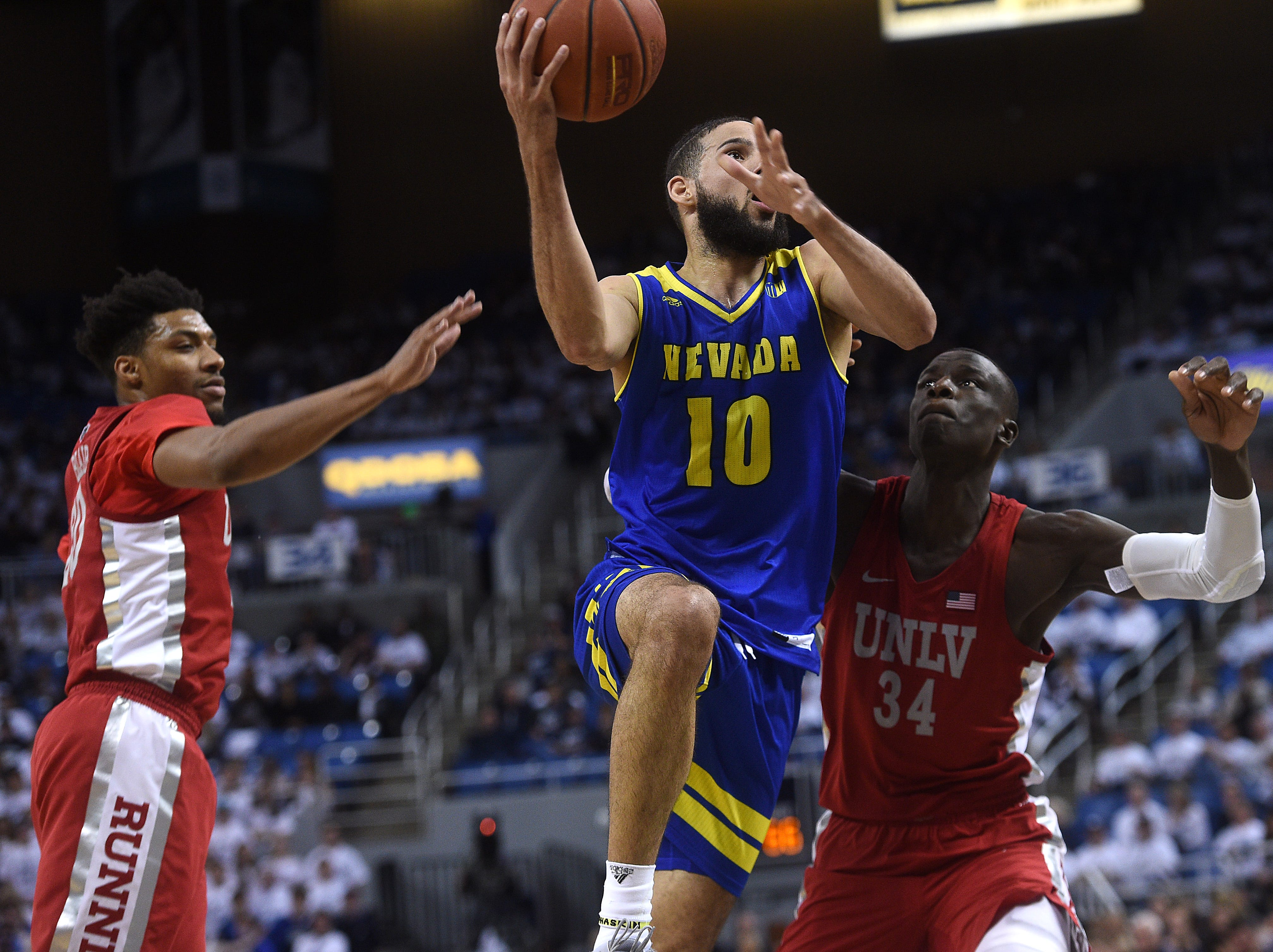 Nevada's Caleb Martin shoots while taking on UNLV during their basketball game at Lawlor Events Center in Reno on Feb. 27, 2019.