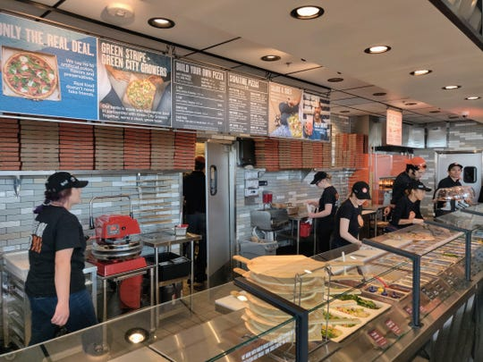 The crew at the new Blaze Pizza in the Outlets at Legends in Sparks gets ready for opening day, Feb. 28, 2019.