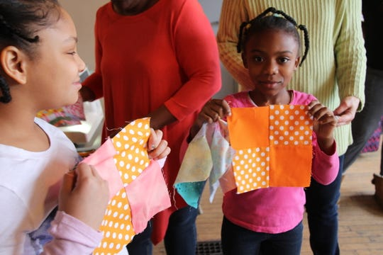 Sisters Nariah Hargrove, 9 and Dezirae Hargrove, 7 share some of the squares they've made in a new-quilters quilting group at 441 Ministries in the Beechwood Neighborhood of Rochester.