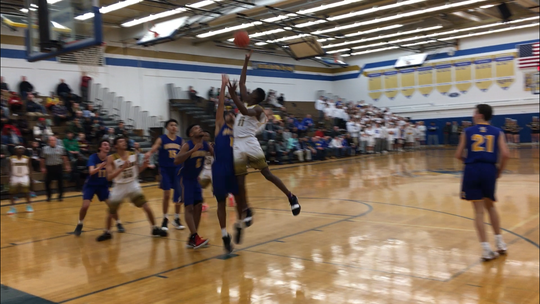 Melvin Council Jr. of Greece Athena puts up a floater against Irondequoit in the Class A1 semifinals.