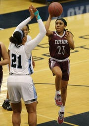 Edison Tech guard Dyaisha Fair (23) looks to float a shot over Bishop Kearney's Saniaa Wilson.